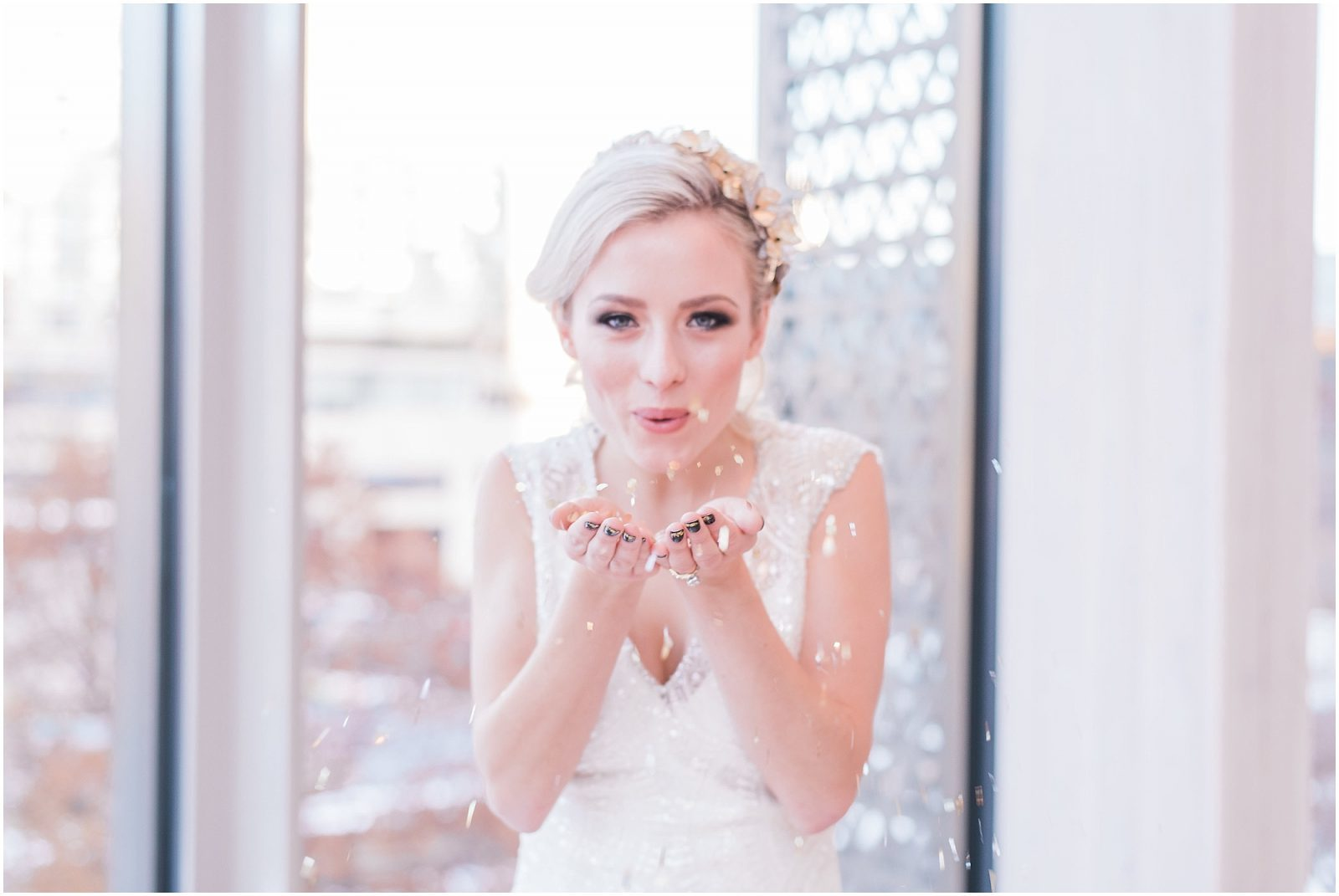 Wedding O'Born Room NAC Ottawa - New Years Glam Wedding Inspiration - bright and airy ottawa wedding photographer - elegant bride blowing sparkles