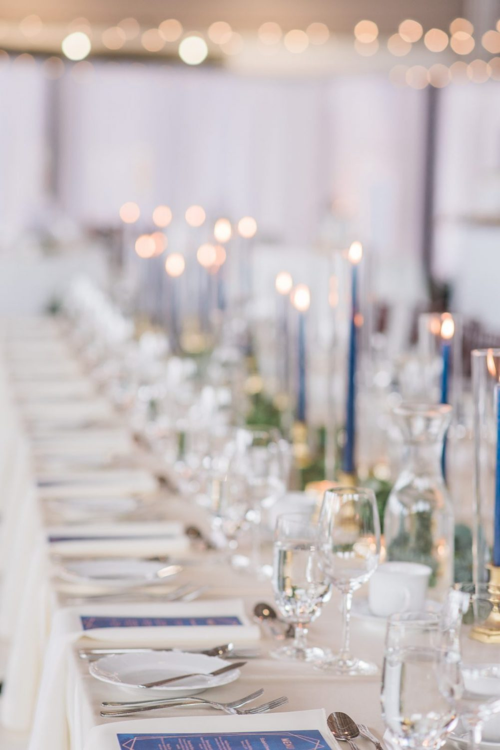 Ottawa wedding decor comapny Sage Events - Horticulture Building - Winter wedding tapered candles in navy - Photography by emma
